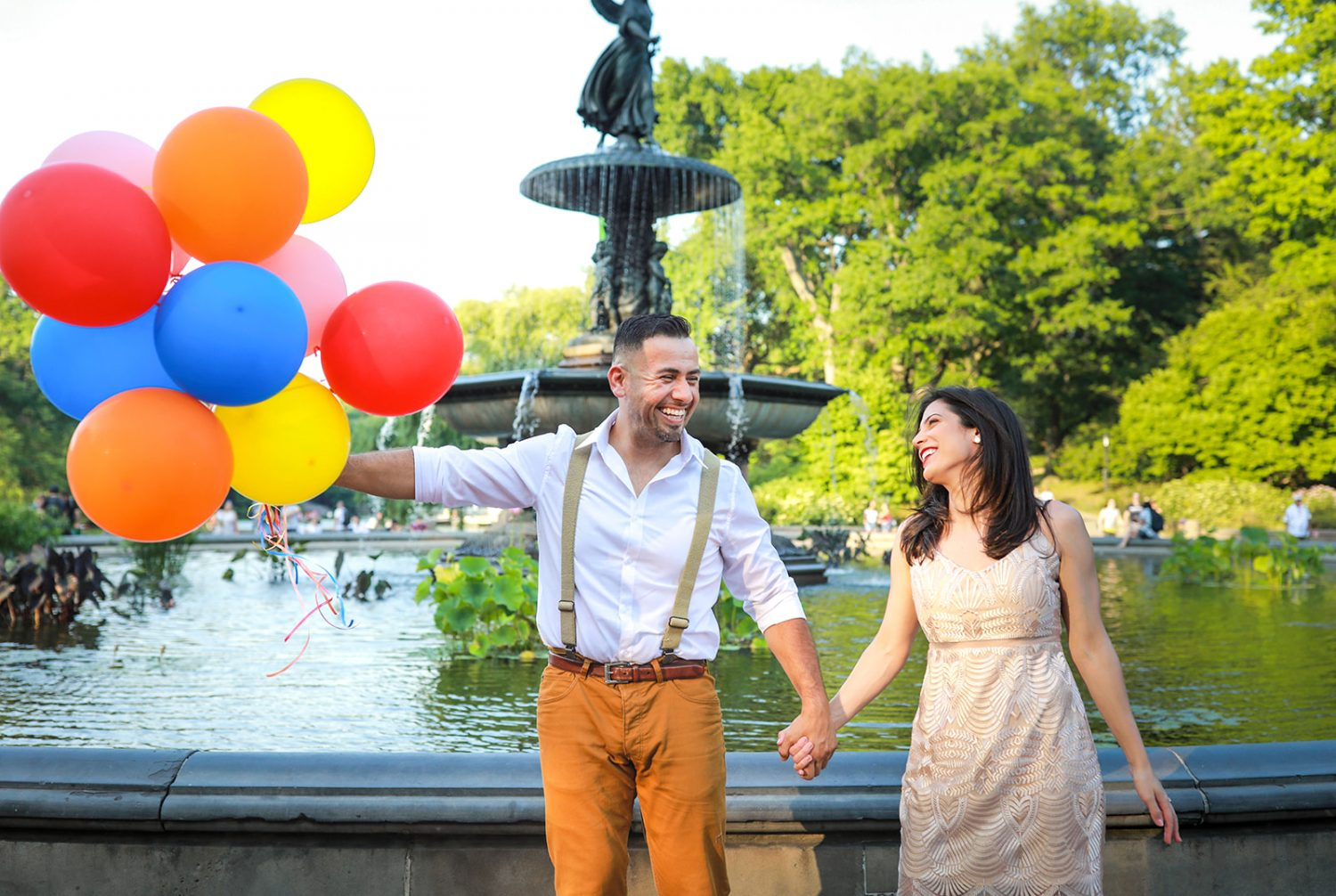 Couple holding colorful balloons for photoshoot in Central Park