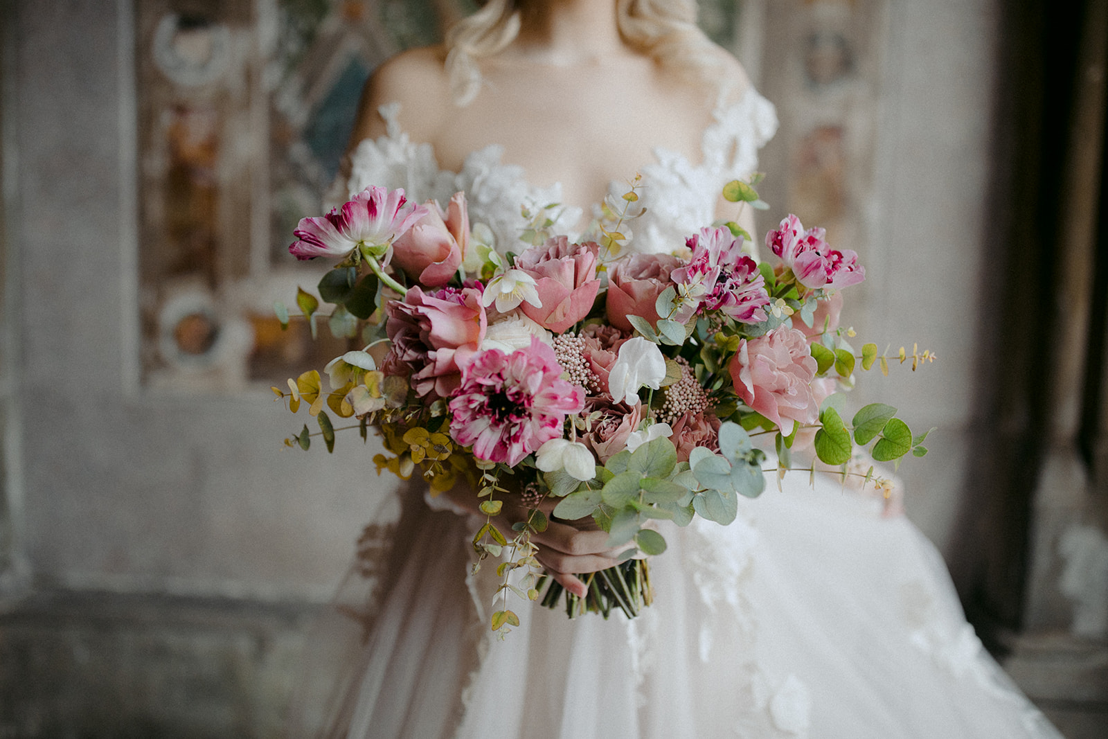 Bride holding bouquet of flowers for wedding photoshoot