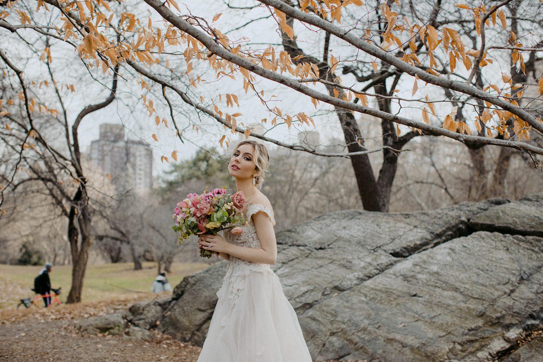 Bride holding flower for wedding photoshoot in Manhattan Central park