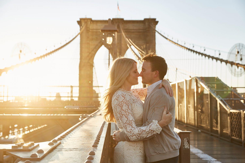 Couple posing for pre-wedding photoshoot at sunrise at Brooklyn Bridge