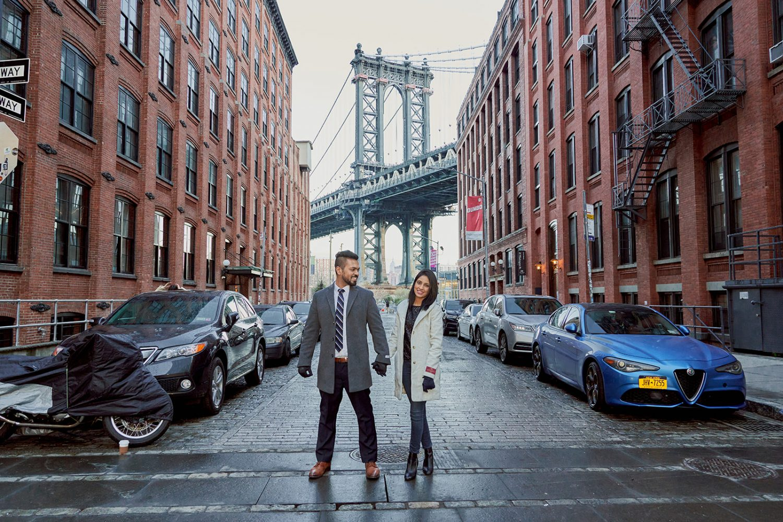 Couple standing in front of Manhattan Bridge in Dumbo for pre-wedding photoshoot